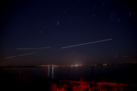 Plane and Star Trails over Bay Bridge